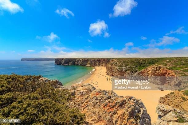 scenic view of sea against cloudy sky - sagres stock pictures, royalty-free photos & images