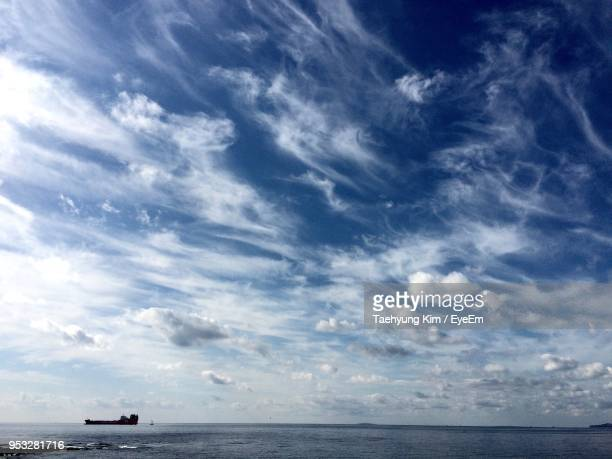 scenic view of sea against cloudy sky - kim taehyung stock pictures, royalty-free photos & images
