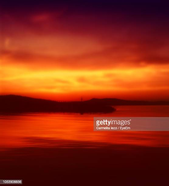 scenic view of sea against dramatic sky during sunset - carmelita iezzi stock pictures, royalty-free photos & images