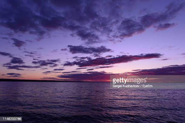 scenic view of sea against dramatic sky during sunset - sergei stock pictures, royalty-free photos & images