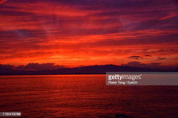 scenic view of sea against dramatic sky during sunset - red sky stock pictures, royalty-free photos & images