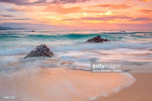 scenic view of sea against dramatic sky during sunset - mindanao stock pictures, royalty-free photos & images