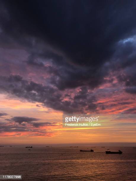 scenic view of sea against dramatic sky during sunset - frederick - fotografias e filmes do acervo