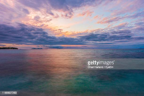 scenic view of sea against dramatic sky during sunset - fiji stock pictures, royalty-free photos & images