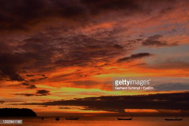 scenic view of sea against dramatic sky during sunset - gerhard schimpf stock pictures, royalty-free photos & images