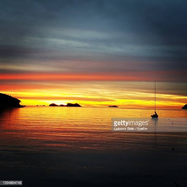 scenic view of sea against dramatic sky during sunset - ljubomir belic stock pictures, royalty-free photos & images