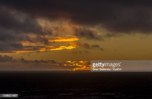 scenic view of sea against dramatic sky during sunset - lancashire stock pictures, royalty-free photos & images