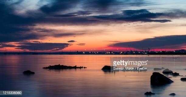scenic view of sea against dramatic sky during sunset - プール市 ストックフォトと画像
