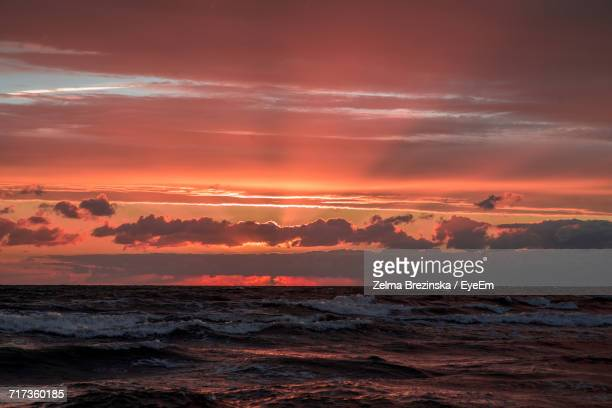 scenic view of sea against dramatic sky during sunset - brezinska stock pictures, royalty-free photos & images