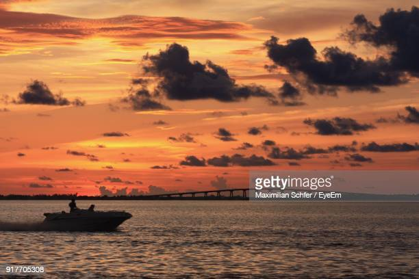 scenic view of sea against dramatic sky during sunset - fort myers stock pictures, royalty-free photos & images