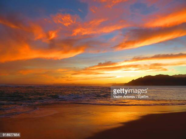 scenic view of sea against dramatic sky during sunset - antonov stock pictures, royalty-free photos & images