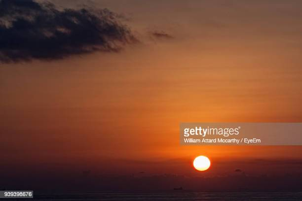scenic view of sea against dramatic sky during sunset - william moon stock pictures, royalty-free photos & images