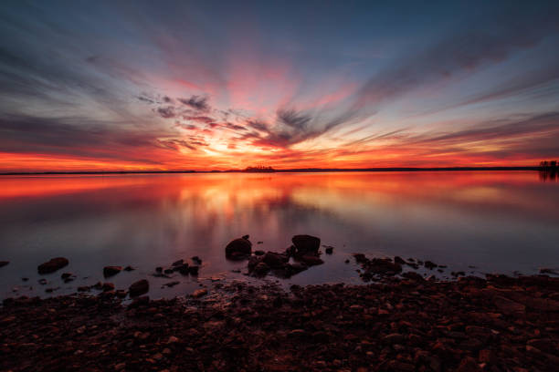Scenic view of sea against dramatic sky during sunset,Oconee County,South Carolina,United States,USA