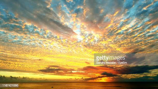 scenic view of sea against dramatic sky - cook islands stock pictures, royalty-free photos & images