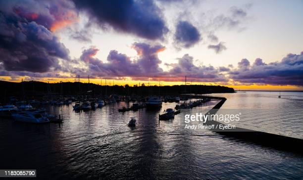 scenic view of sea against dramatic sky - andy rinkoff stock pictures, royalty-free photos & images