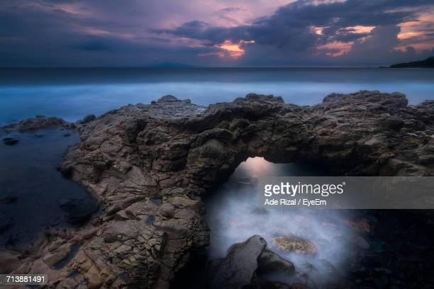 scenic view of sea against dramatic sky - ade rizal stock photos and pictures