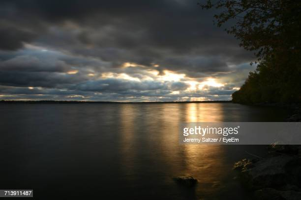 scenic view of sea against dramatic sky - erie pennsylvania stock pictures, royalty-free photos & images