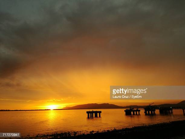 scenic view of sea against dramatic sky - lauro stock pictures, royalty-free photos & images