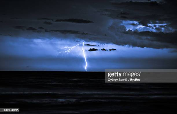 Scenic View Of Sea Against Lightning At Dusk