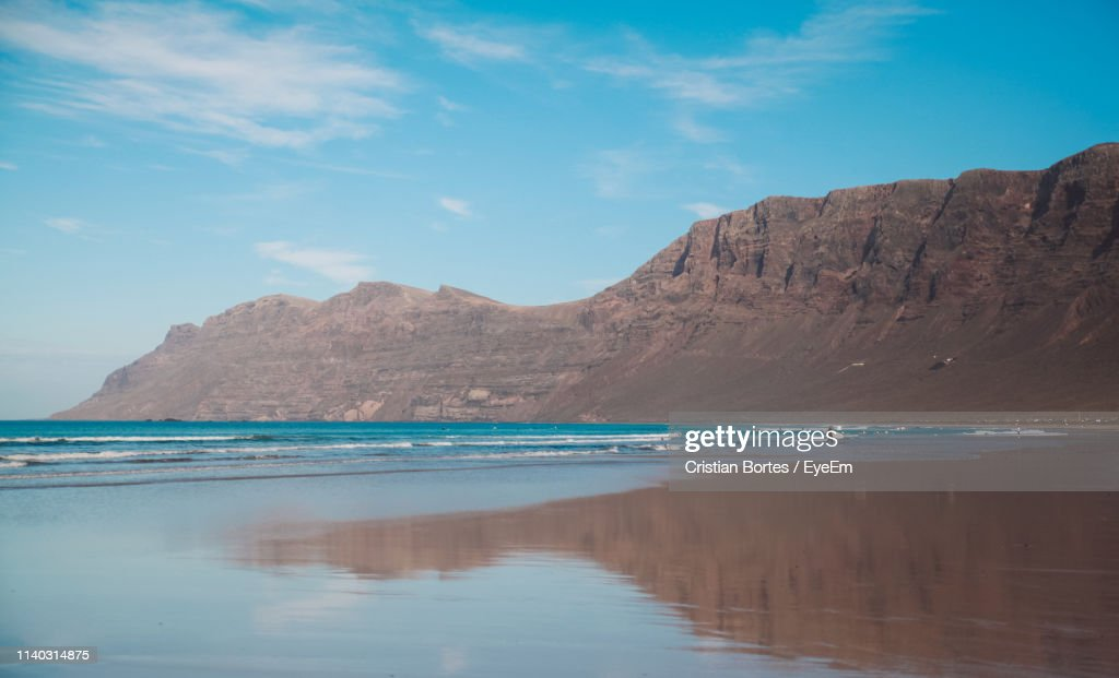 Scenic View Of Sea Against Mountain : Stock Photo