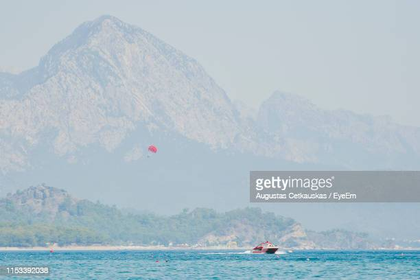 scenic view of sea against mountains - cetkauskas stock pictures, royalty-free photos & images