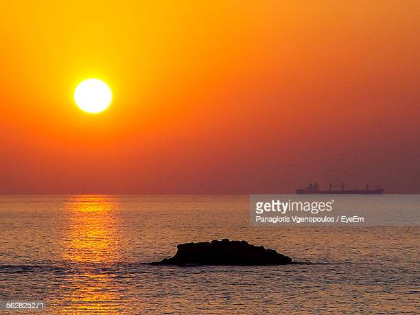 scenic view of sea against orange sky during sunset - vgenopoulos stock pictures, royalty-free photos & images