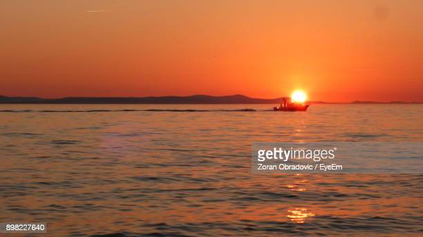 Scenic View Of Sea Against Orange Sky During Sunset