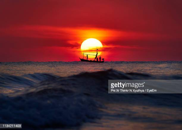 scenic view of sea against orange sky - prachuap khiri khan province stock pictures, royalty-free photos & images
