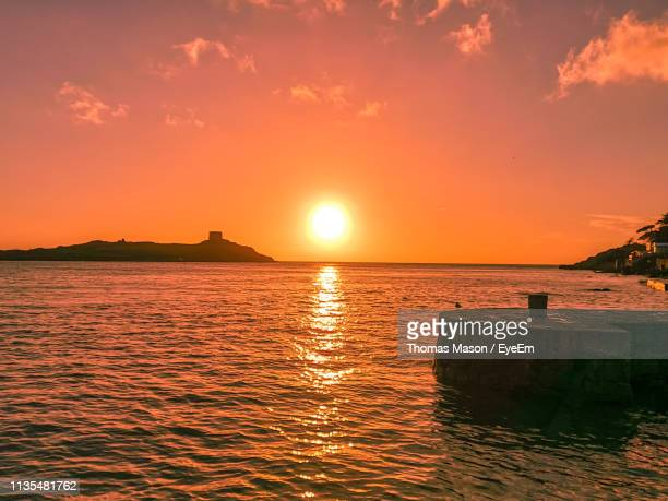 scenic view of sea against orange sky - dalkey stock pictures, royalty-free photos & images