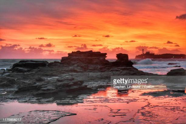 scenic view of sea against orange sky - mooloolaba stock pictures, royalty-free photos & images