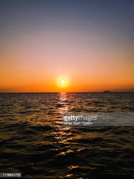 scenic view of sea against orange sky - bedtime stock pictures, royalty-free photos & images