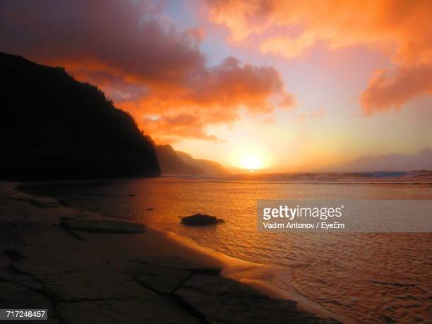 scenic view of sea against orange sky - antonov stock pictures, royalty-free photos & images