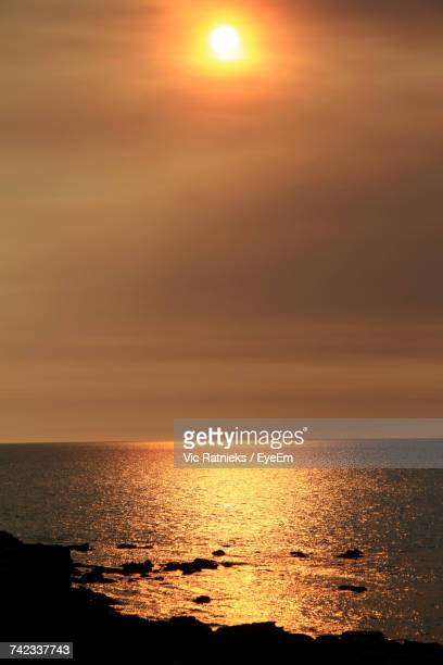 scenic view of sea against orange sky - ratnieks stock pictures, royalty-free photos & images
