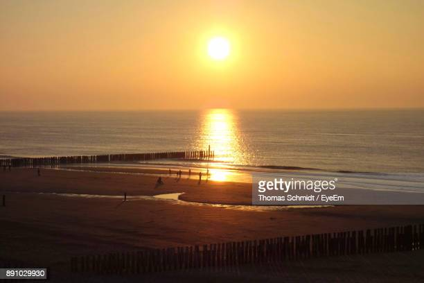 scenic view of sea against orange sky - day of the week stock pictures, royalty-free photos & images