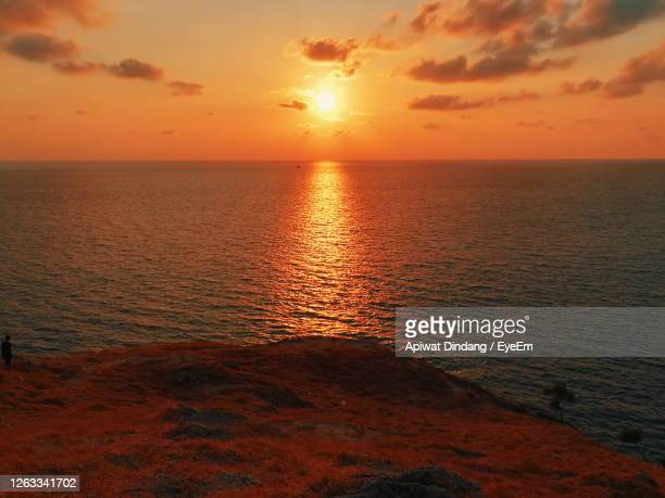 scenic view of sea against romantic sky at sunset - golden hour stock pictures, royalty-free photos & images