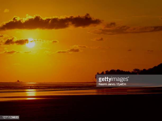 scenic view of sea against romantic sky at sunset - naomi jarvis stock pictures, royalty-free photos & images