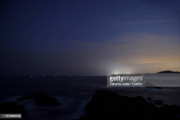 scenic view of sea against sky at night - iwate prefecture stock photos and pictures