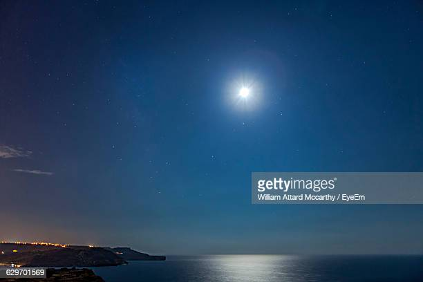 scenic view of sea against sky at night - william moon stock pictures, royalty-free photos & images