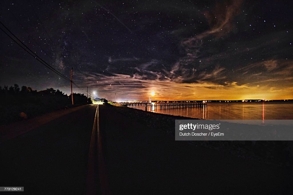 Scenic View Of Sea Against Sky At Night : Photo