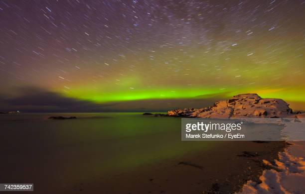scenic view of sea against sky at nightenic - marek stefunko stock photos and pictures