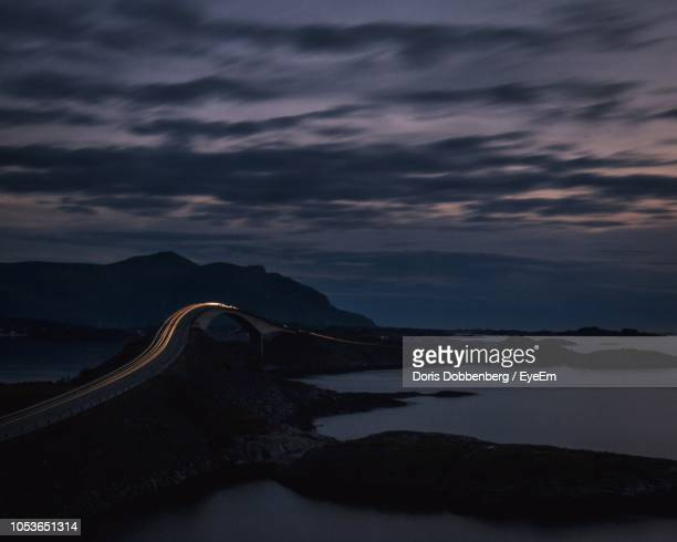 scenic view of sea against sky at sunset - atlantic road norway photos et images de collection
