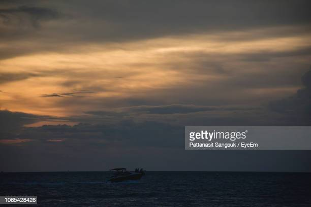 scenic view of sea against sky at sunset - pattanasit stock pictures, royalty-free photos & images