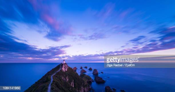 scenic view of sea against sky at sunset - invercargill stock pictures, royalty-free photos & images