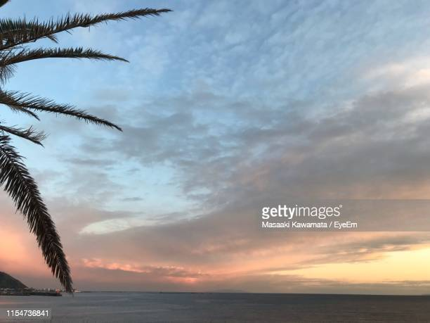scenic view of sea against sky at sunset - zushi kanagawa stock photos and pictures
