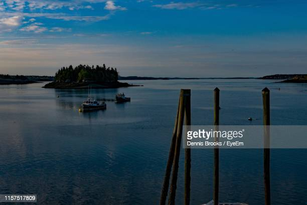 scenic view of sea against sky at sunset - lubec stock photos and pictures