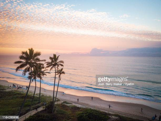 scenic view of sea against sky at sunset - gold coast stock pictures, royalty-free photos & images