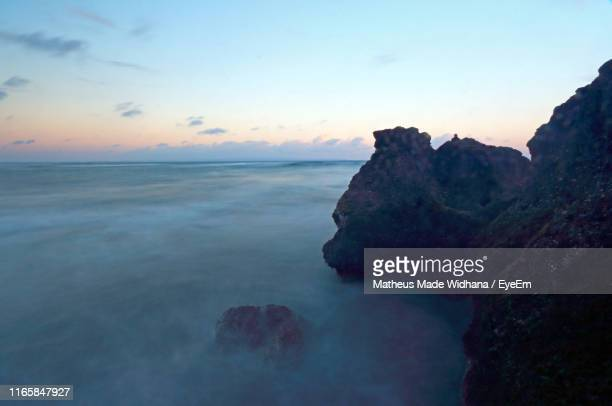 scenic view of sea against sky at sunset - made widhana stock photos and pictures