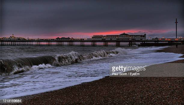 scenic view of sea against sky at sunset - brighton beach england stock pictures, royalty-free photos & images