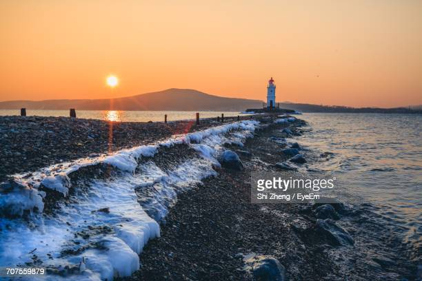 scenic view of sea against sky at sunset - dandong stock pictures, royalty-free photos & images