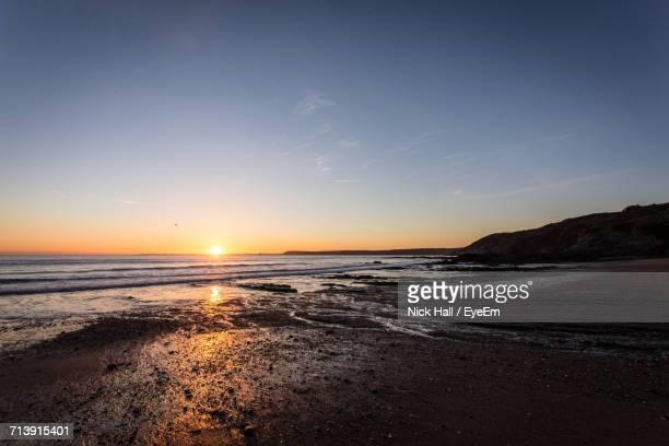 scenic view of sea against sky at sunset - mevagissey stock photos and pictures